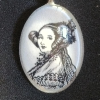 A glass pendant with a black and white portrait of Ada Lovelace