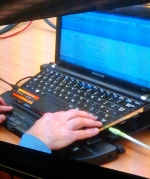 Picture of a laptop with screen reader attached
