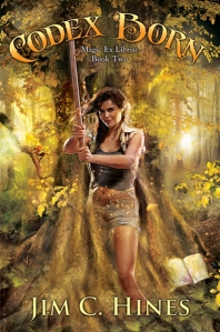 "Book cover with the words ""Codex Born"" and a smiling woman standing straight and holding a sword"