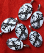 5 Ada Lovelace pendants on a red background