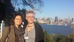 Two women, a river, and downtown Manhattan