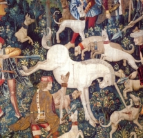 Tapestry of unicorn bucking in the midst of dogs and hunters