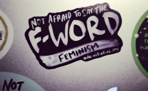 Silver laptop with f-word sticker on it