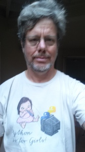 "Guido van Rossum wearing ""Python is for girls"" shirt"