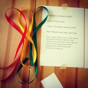 Coloured lanyards to indicate photo preferences