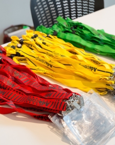 AdaCamp lanyards in red, yellow, and green with patterns for colorblind visibility