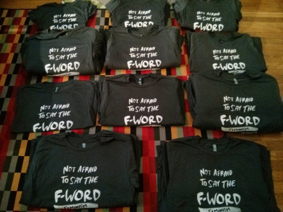 F-word Feminism shirts, laid out by sizes
