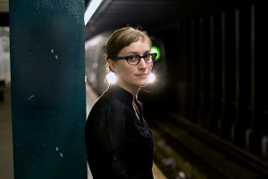 Photograph of Alicia Gibb, with an approaching subway car in the background