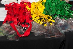 Piles of lanyards in each of red, yellow and green. By Flore Allemandou CC BY-SA.