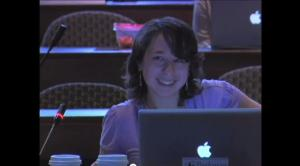 Photograph of Kendra Albert, with laptop