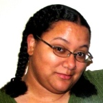 A woman with raised eyebrows wearing glasses